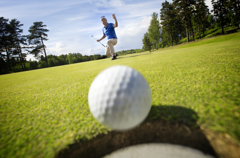 Golfer excited ball in hole