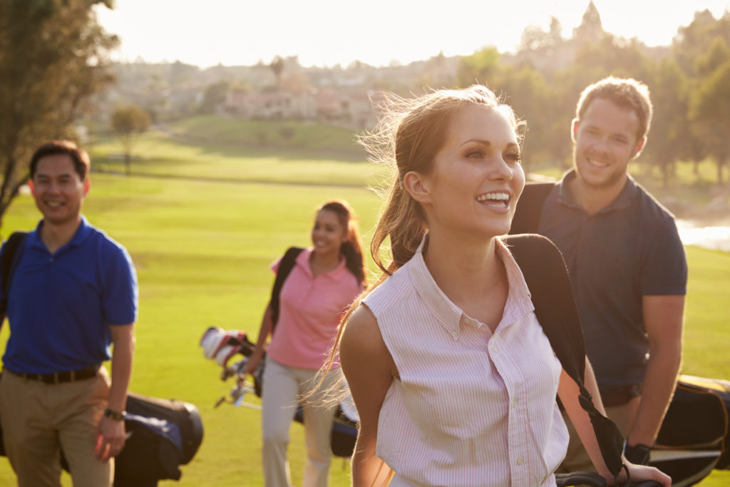 Happy golfers walking