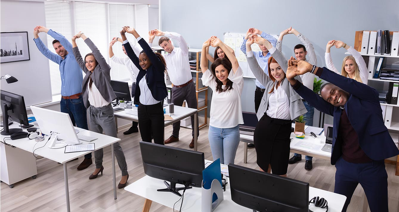 Office employees stretching