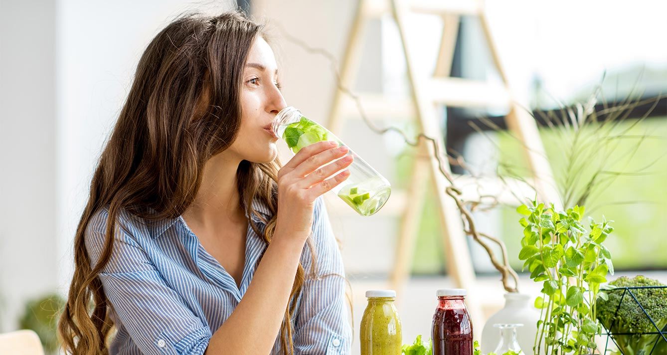 Woman drinking healthy water and smoothies