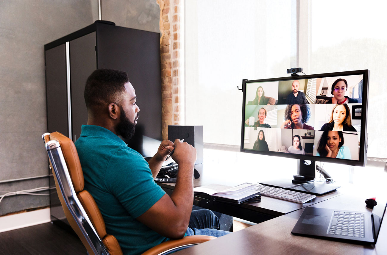 man working from home having a video conference
