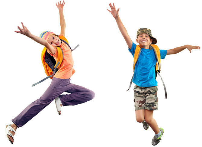 Happy Students wearing backpacks jumping in the air