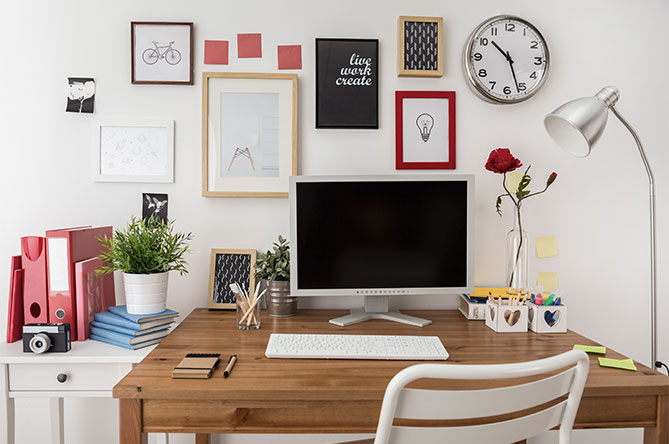 Trendy home desk with computer and accessories
