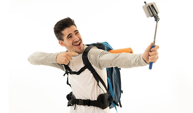 Student wearing backpack taking selfie