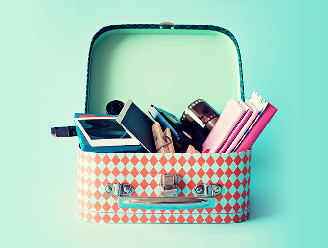 Tin lunch box with notebooks and photography supplies
