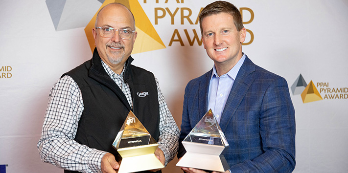Gary Biron and Chris McKee accepting PPAI Pyramid Awards
