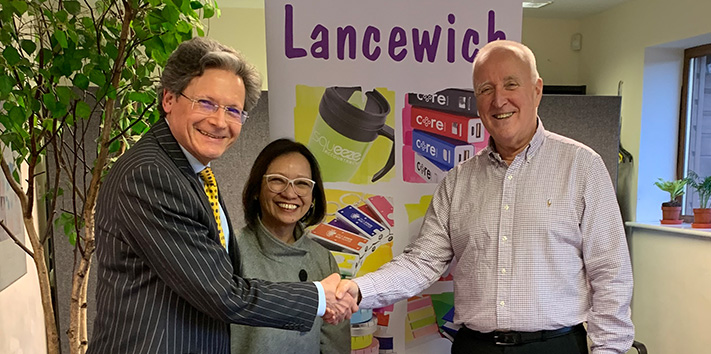 Nicholas Martin and Jessie Wong of Lancewich shake hands with Frank Murphy of GeigerBTC