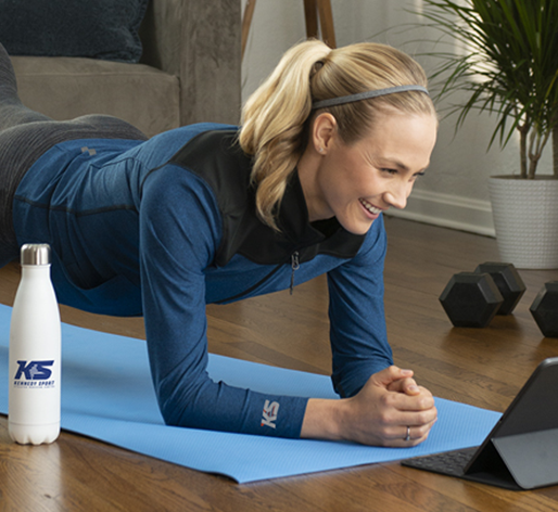 Woman exercising at home with promo products